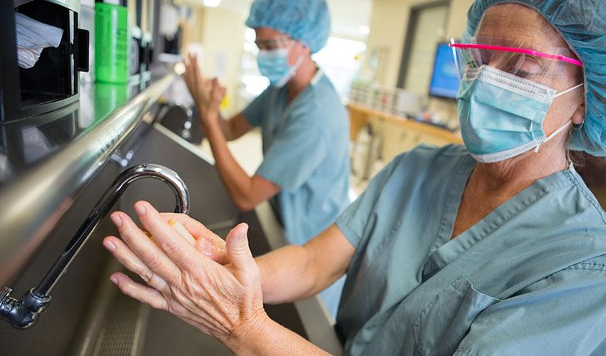doctors scrubbing up