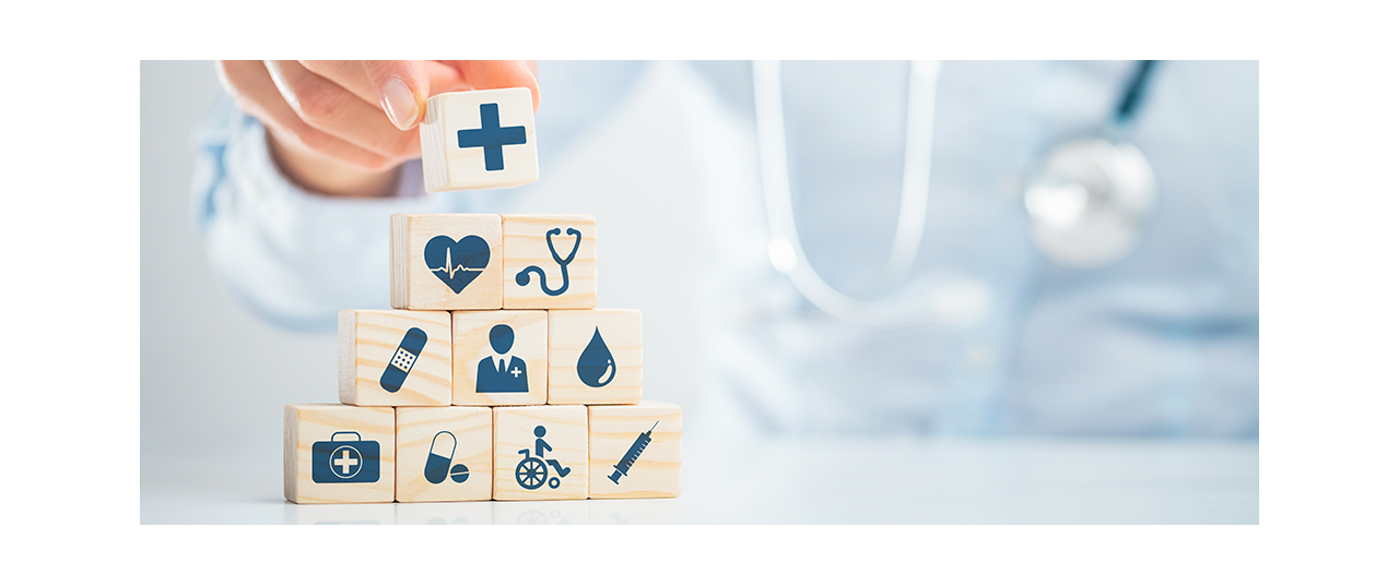 Individual stacking blocks with healthcare symbols.