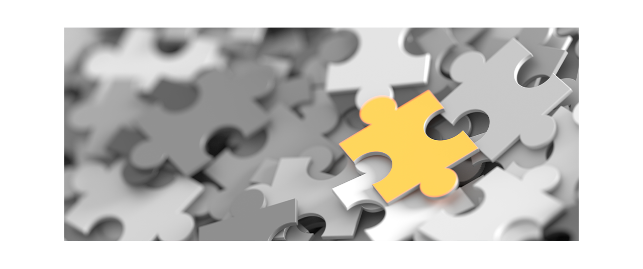 Gray puzzle pieces with single yellow puzzle piece