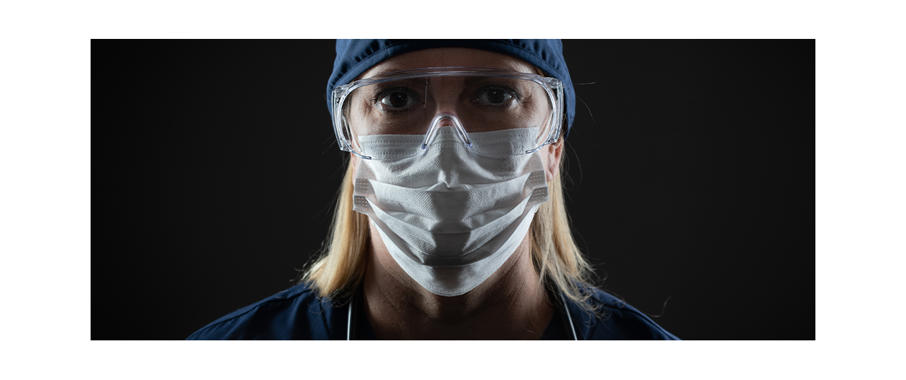 Female clinician in PPE with black background