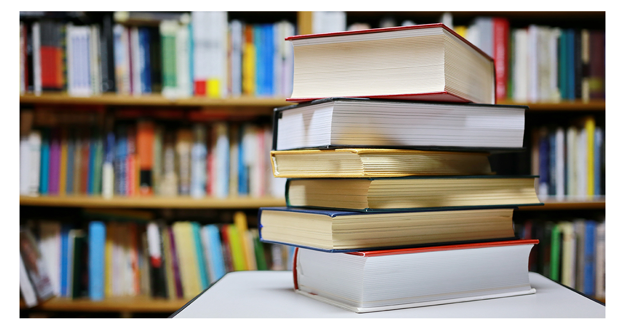 Stack of books on a table in a library