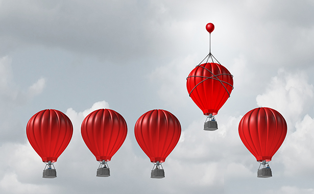 Five red hot air balloons in an overcast sky with the fourth from the last ascended higher than the others